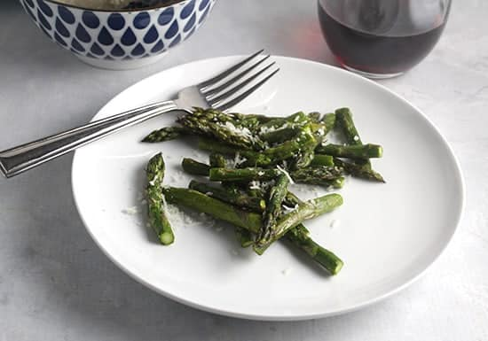 roasted asparagus with parmesan on a plate.