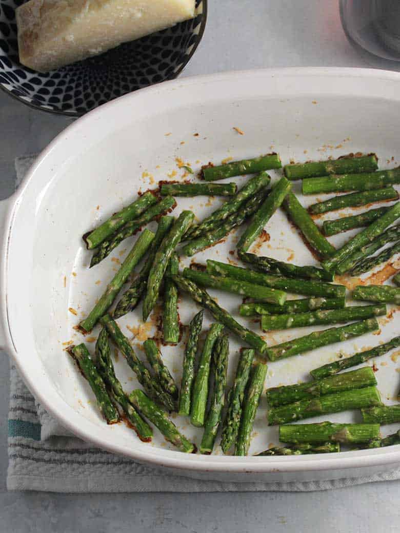 roasted asparagus with Parmesan in a baking dish.