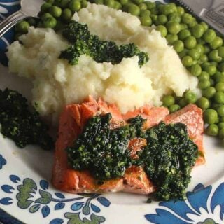 pan seared salmon topped with pesto, alongside some mashed potatoes for some healthy green Irish food. #SundaySupper #StPatricksDay #Irishfood #seafood