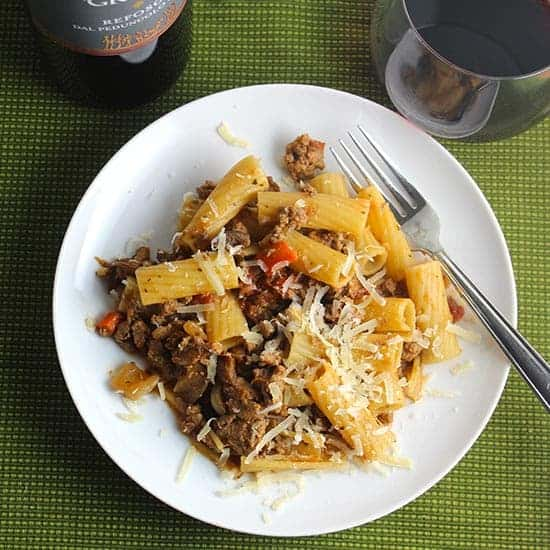 turkey bolognese pasta on a white plate.