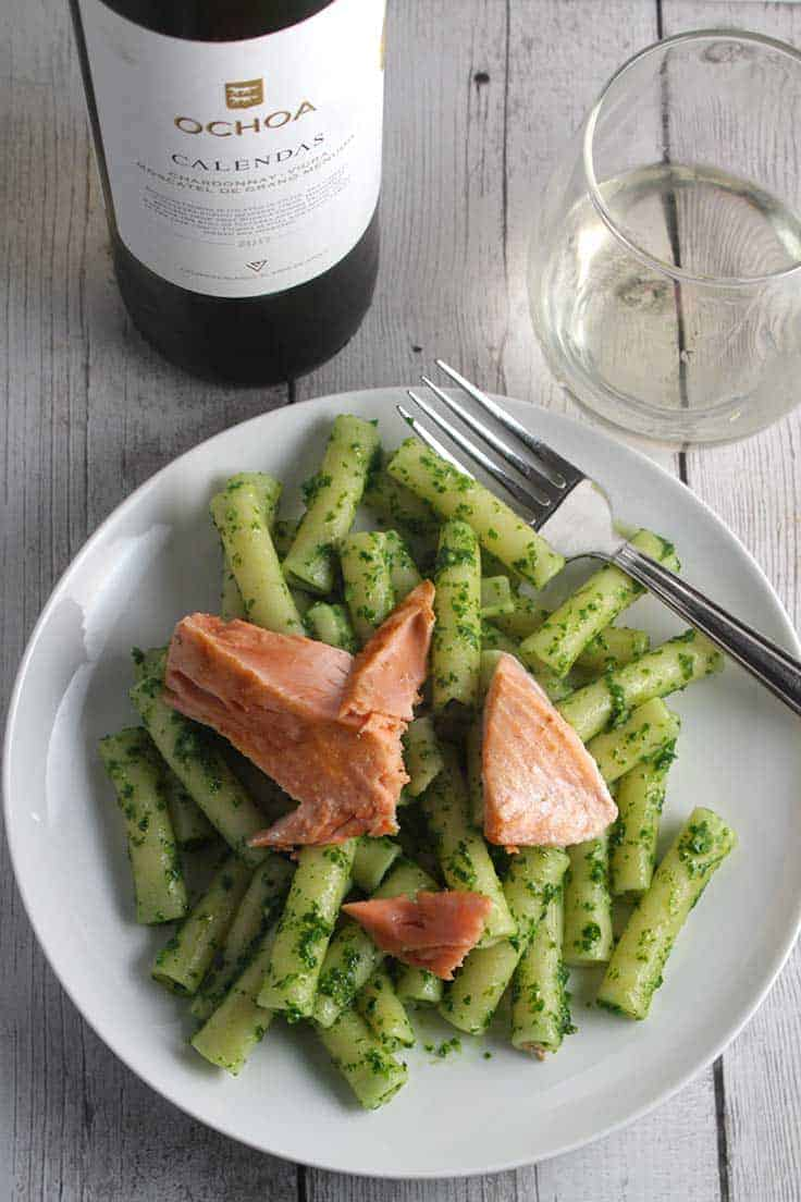 plate of pasta with pesto and salmon