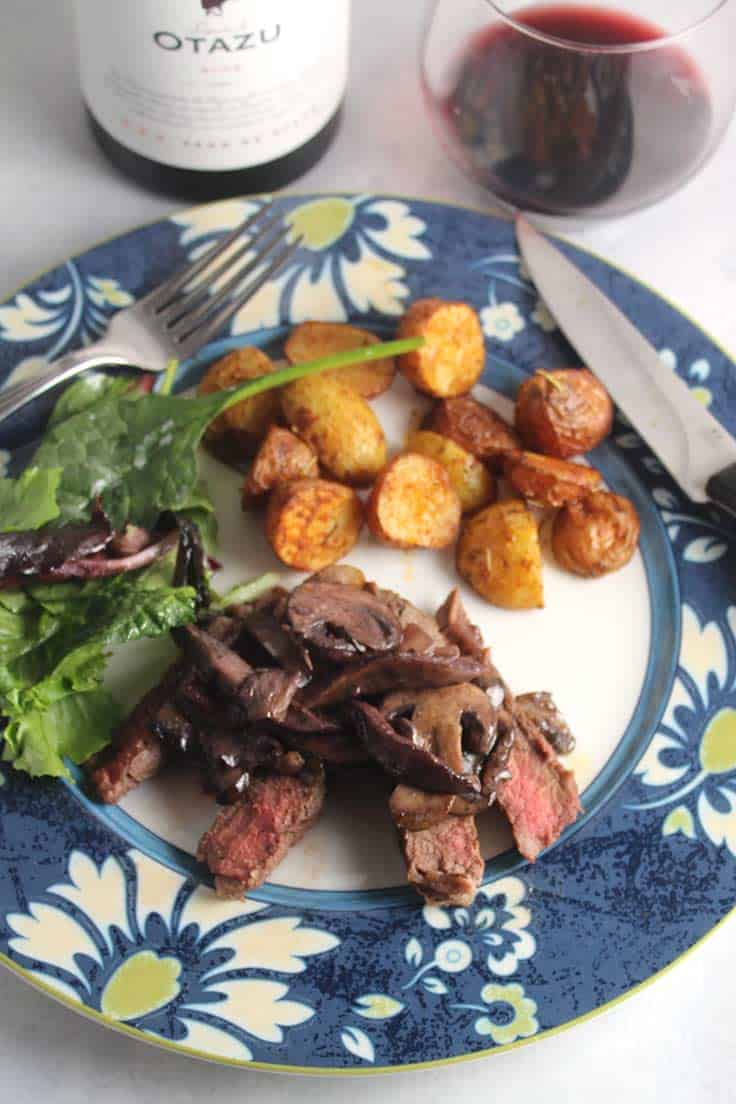 Roasted sirloin steak topped with a delicious Manchego Mushroom Sauce. Wonderful with a red wine from Navarra, Spain. #sauces #steak #Manchego #winepairing #Navarra #sponsored