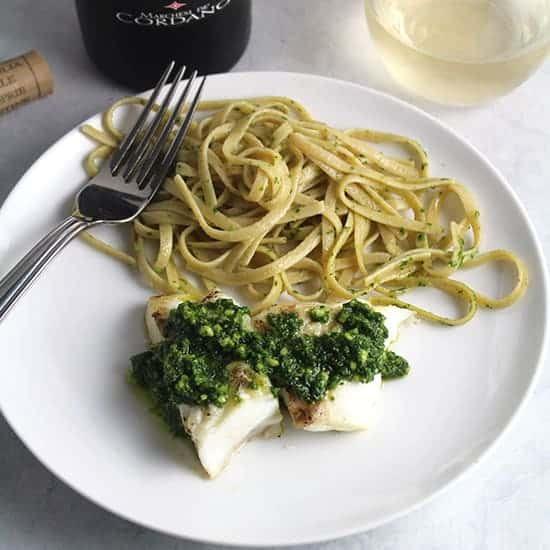 grilled halibut topped with kale pesto and a side of linguine.