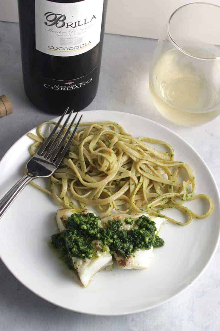 grilled halibut with kale pesto, served with a white wine.