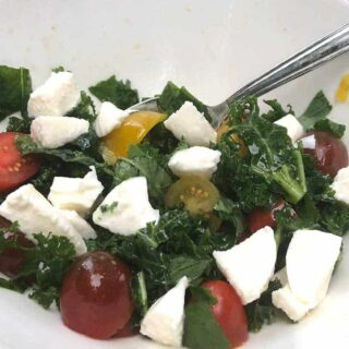 kale caprese salad in a bowl