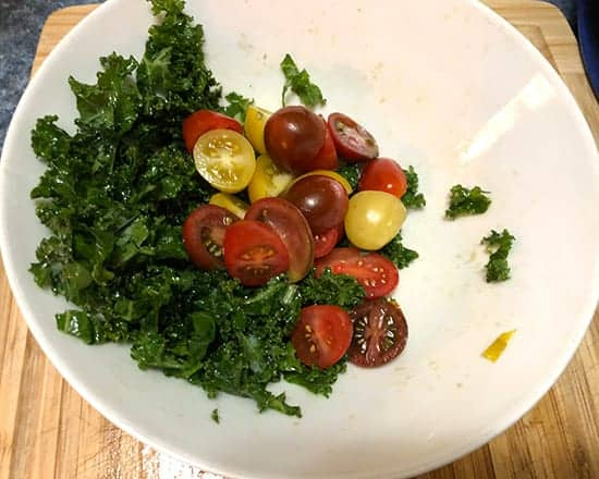 making kale caprese salad.