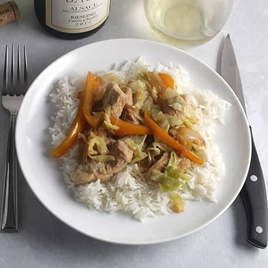pork and cabbage skillet served with a Riesling.