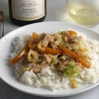pork and cabbage skillet over rice, served with a Riesling.