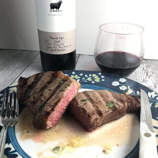 grilled steak with garlic butter and Hugh Hamilton Black Ops wine.