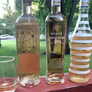 Three bottles of Provence rosé wine.