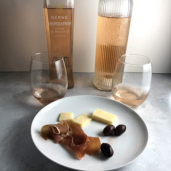 two Provence rose wines paired with cheese, ham and olives.