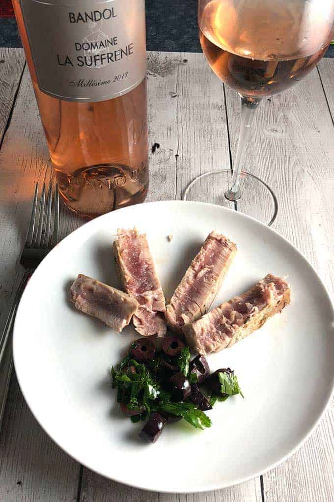 pan seared plated with olive relish, served with a rosé wine.