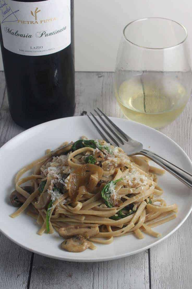 Spinach and Mushroom Pasta, with a bit of prosciutto, is delicious paired with Malvasia Puntinata, a white wine from the Lazio region of Italy. #pasta #winepairing #Italianfood