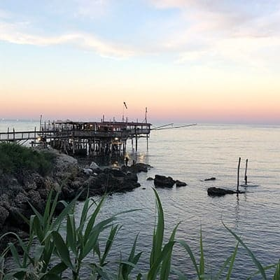 sunset at a trabocco fishing pier in Abruzzo.