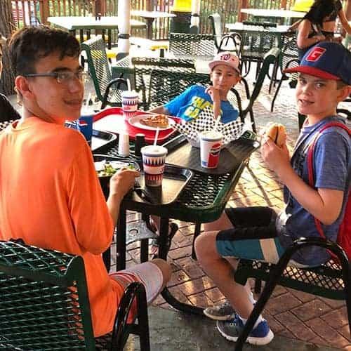 boys eating dinner at the Trellis, a restaurant at Canobie Lake Park.