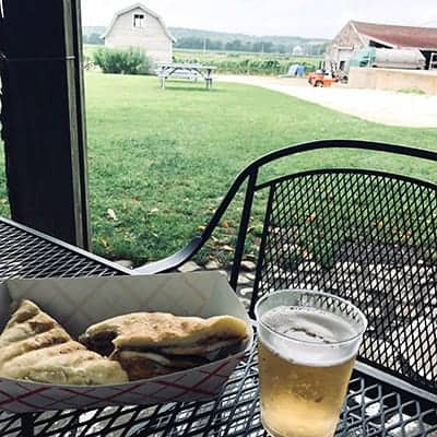 cuban sandwich with a glass of sparking wine on patio at Westport Rivers Vineyard.