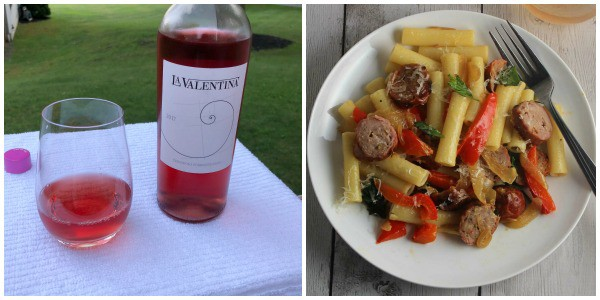 bottle of La Valentina Cerasualo wine alongside ziti with sausage