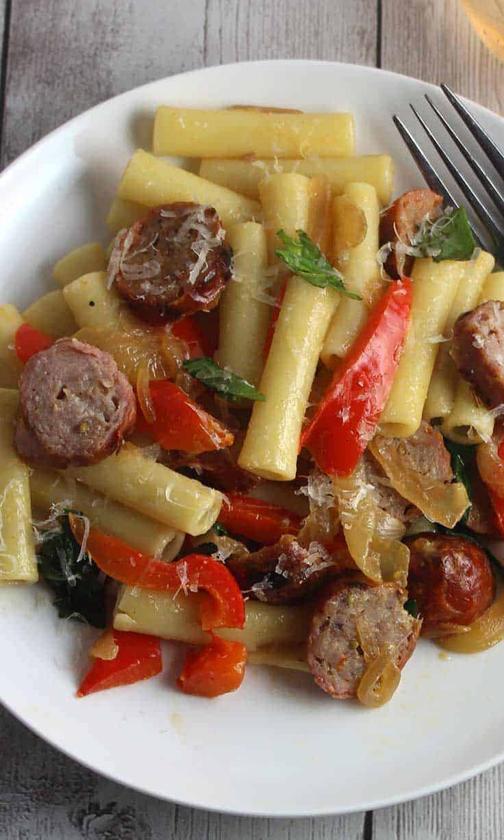 plate with pasta, sausages and peppers