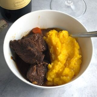 BBQ beef stew served with butternut squash purée.