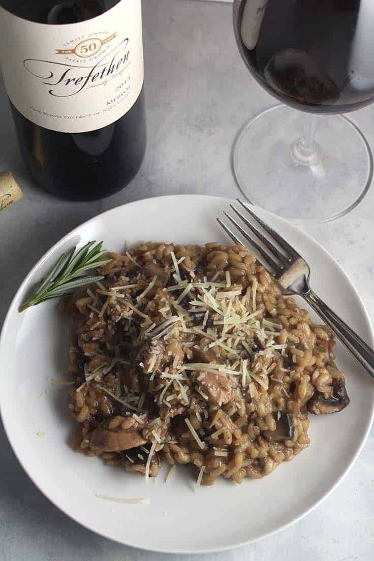 Chicken and Mushroom Risotto, a hearty recipe that pairs well with a good Merlot. #winepairing #risotto
