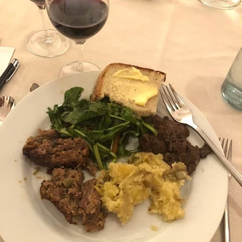 sautéed porcini on a plate with meatloaf and potatoes.