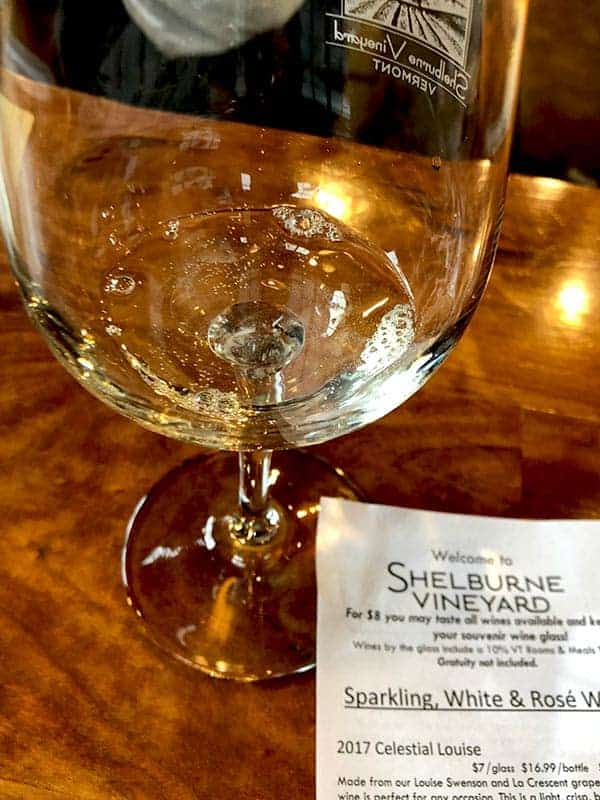 glass of wine and tasting sheet at Shelburne Vineyard.