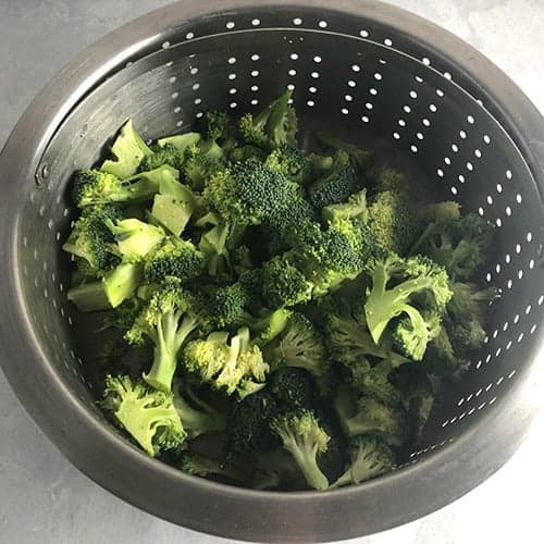 broccoli florets in a steamer.