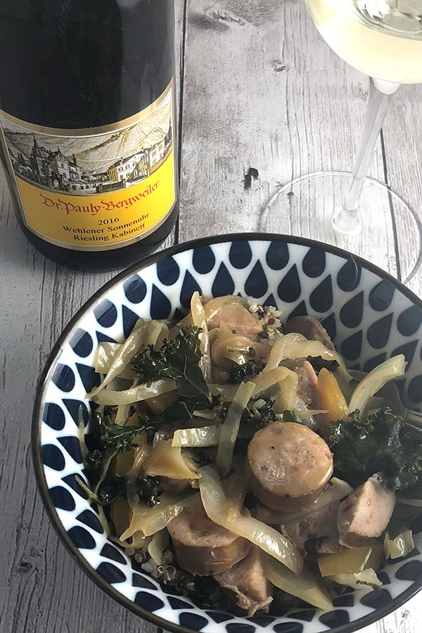 chicken sausage veggie bowl served with white wine.