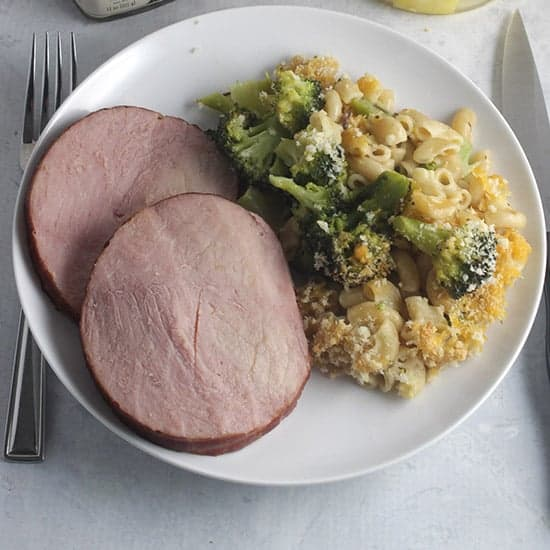 ham and broccoli cheddar casserole on a plate.