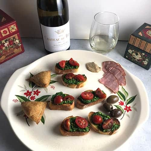 pairings for Pouilly-Fumé arranged on a holiday platter.