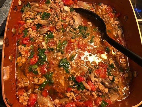 Healthy Bolognese Sauce cooking on the stove top.
