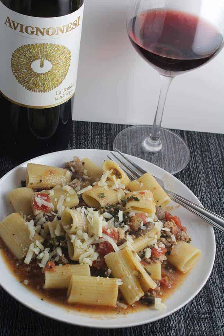 plate of healthy bolognese with sauce and red wine.