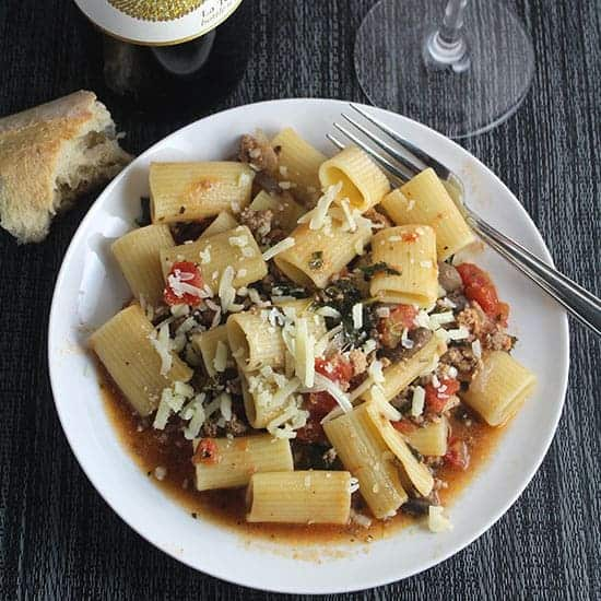 healthy Bolognese sauce served with rigatoni and bread on the side.
