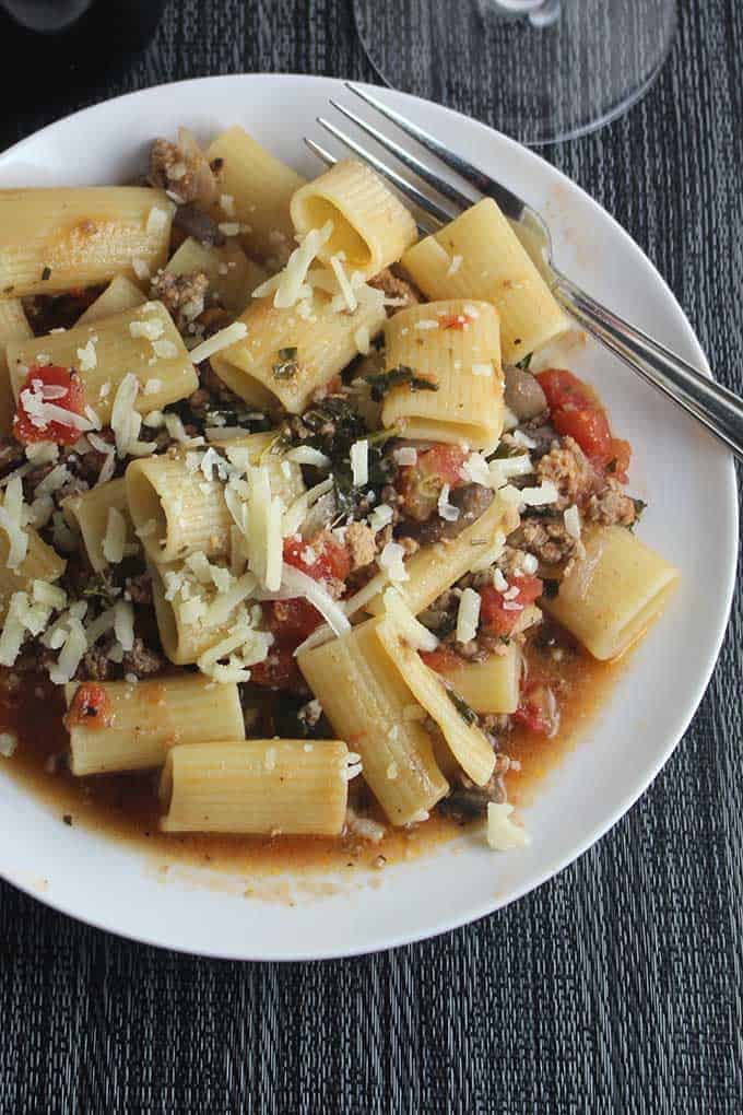 turkey, mushrooms, and grass fed beef simmer for a hearty yet healthier Bolognese sauce. delicious with a good glass of Italian red wine. #pasta #healthyrecipes #Bolognese #winepairing