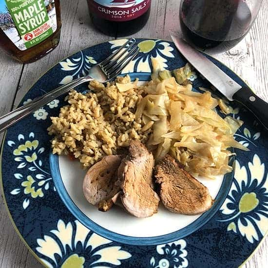 Maple Pork Tenderloin plated with rice and cabbage.