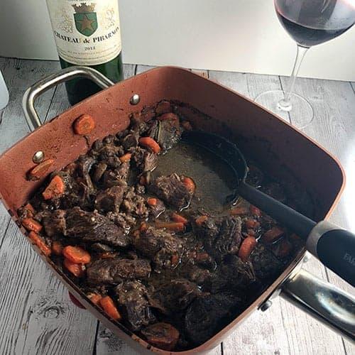 beef daube in copper pan.