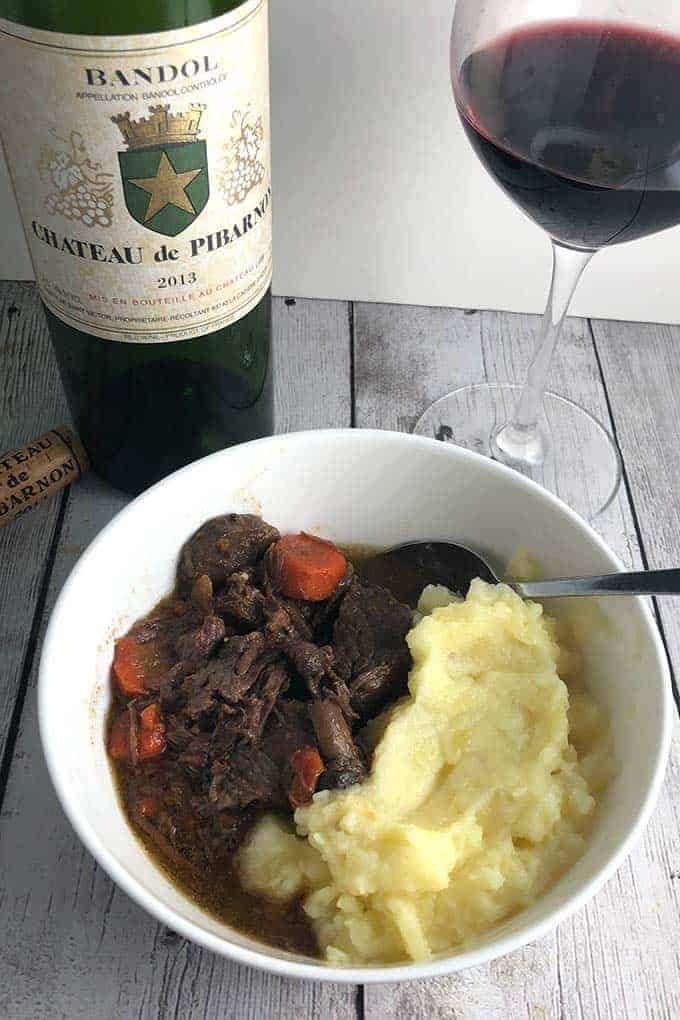 Beef Daube Provençal is a classic beef stew from Southern France. Beef slowly cooks with vegetables and herbs for a satisfying, delicious meal. #beefstew #FrenchFood #winophiles