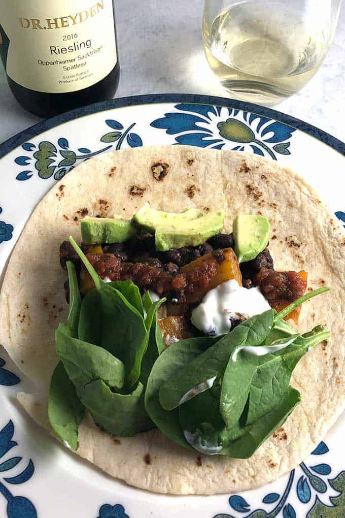 Easy Black Bean Tacos with Avocado recipe, with chipotle salsa, is a tasty weeknight meal. Pairs well with German Riesling. #tacos #blackbeans #Riesling #sponsored
