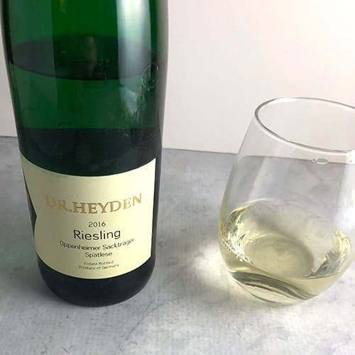 Dr. Heyden Riesling bottle and a glass beside it.
