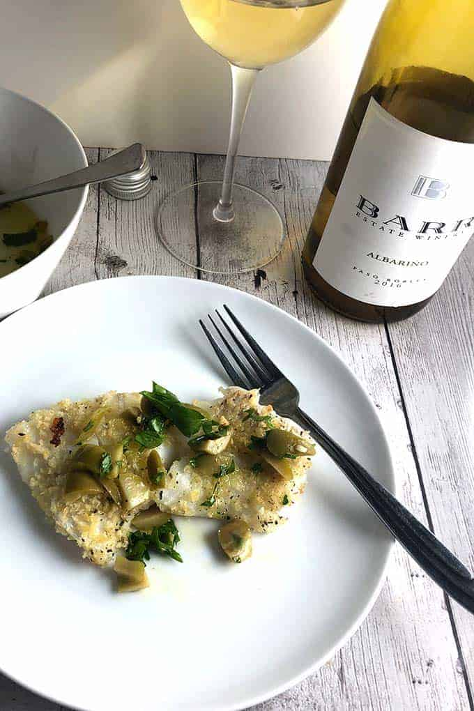 easy baked cod recipes is delicious topped with an olive lemon relish! even better paired with an Albariño white wine from Paso Robles. #seafood #winepairing #cod #sponsored