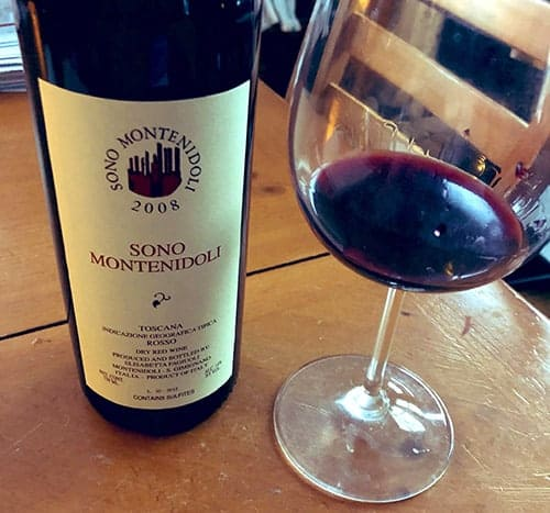 Bottle and glass of Sono Montenidoli Tuscan Sangiovese.