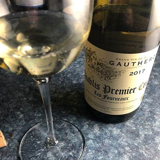 bottle of Les Fournaux Chablis with a glass poured.