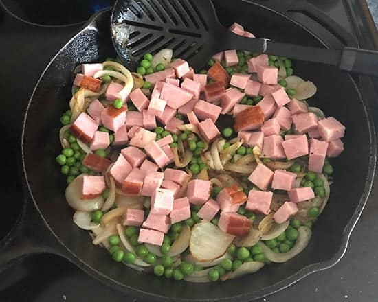 ham, peas and onion in a skillet.