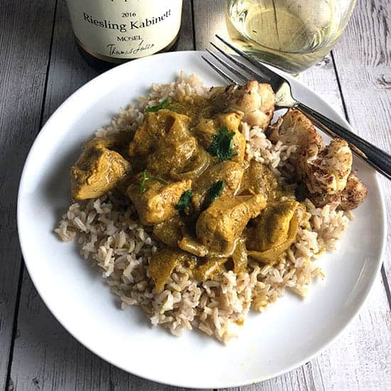 Indian butter chicken served with Riesling wine.