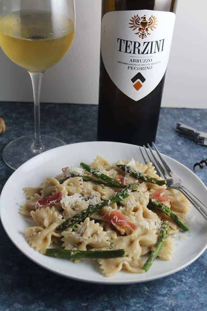 plated of roasted asparagus pasta with wine pairing.