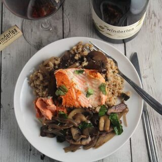 salmon with farro and mushrooms served with Pinot Noir.