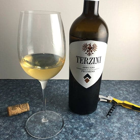 bottle and glass of Terzini Pecorino white wine.