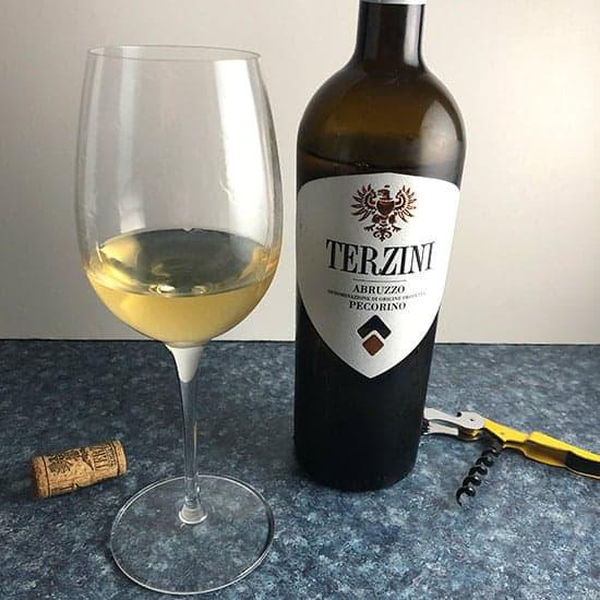 bottle and glass of Terzini Pecorino white wine.
