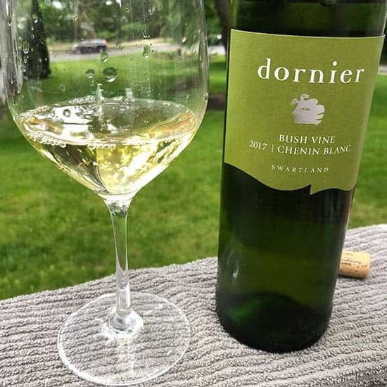 Bottle and glass of Dornier Chenin Blanc.