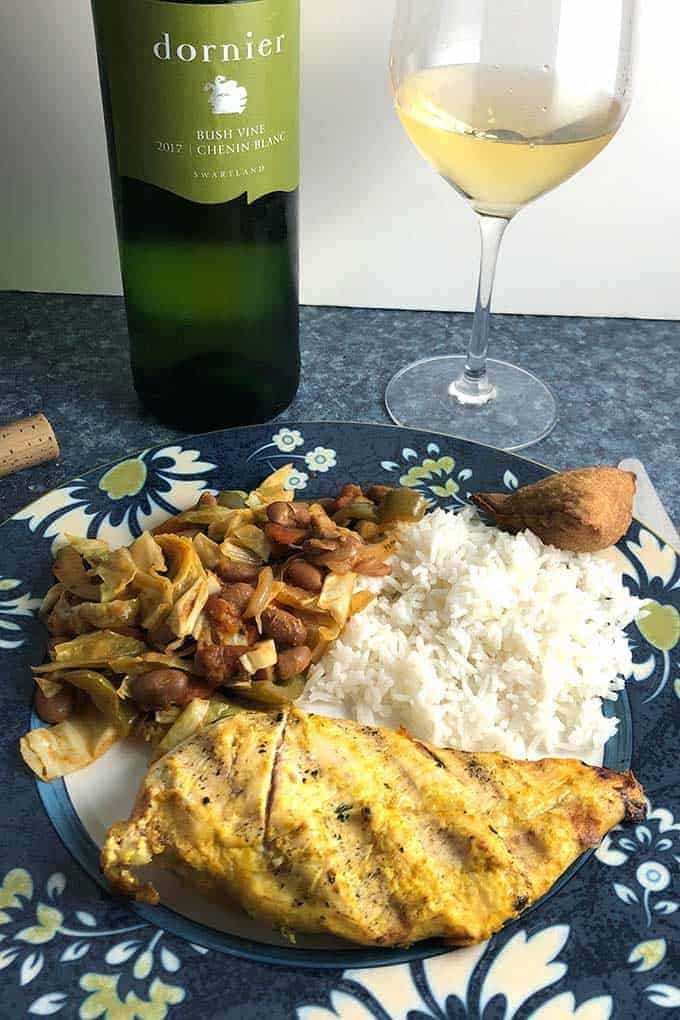 South African Chicken plated with chakalada and served with Chenin Blanc white wine.